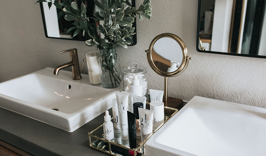 Wedding day makeup and skincare products on sink