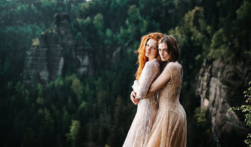 Two brides posing with modern wedding day makeup