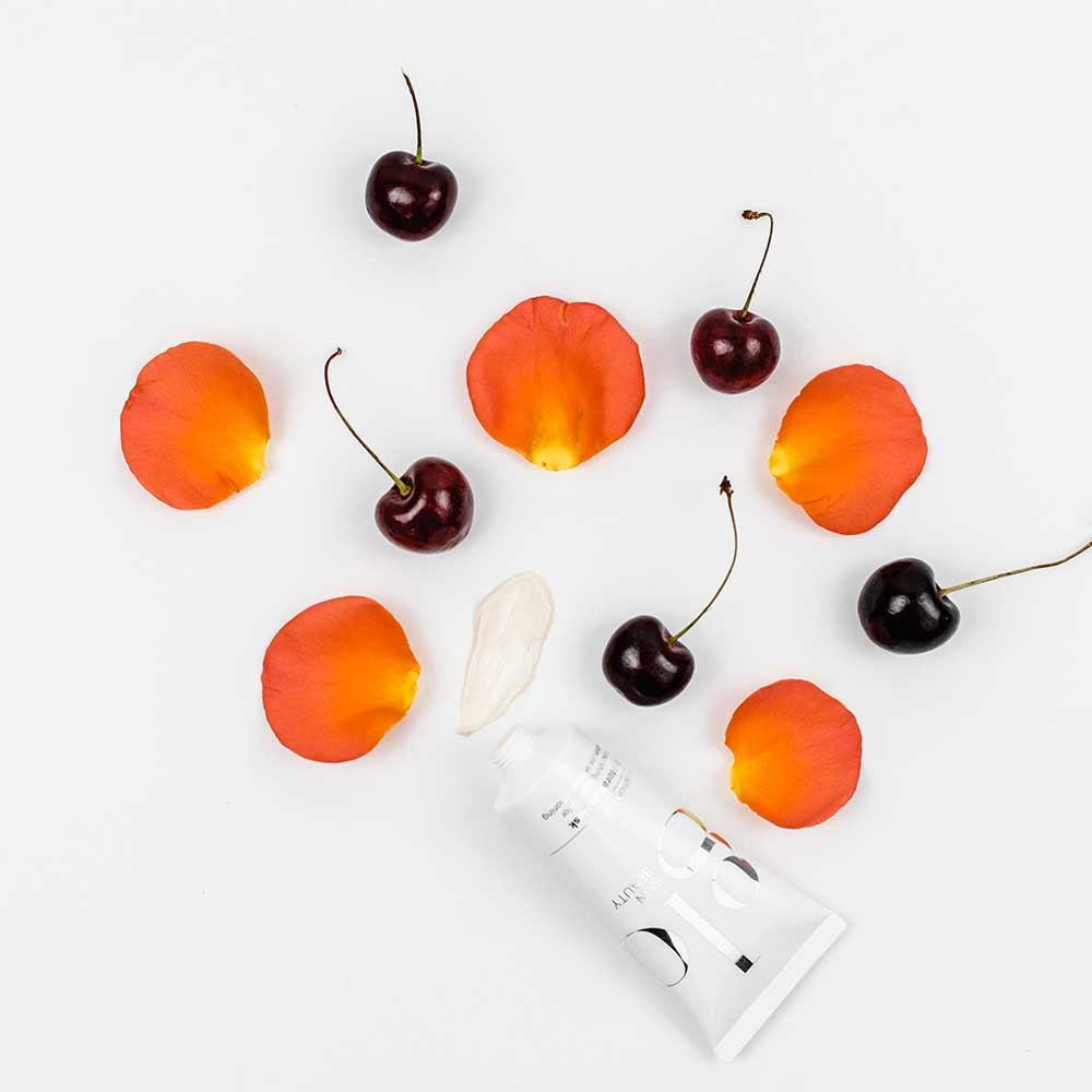 glo skin beauty product with cherries & petals