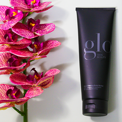 glo skin beauty product next to flowers