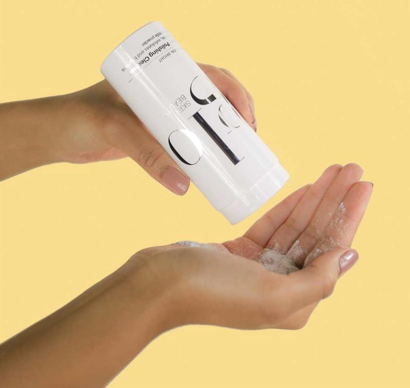 glo skin beauty polishing cleanser in hands