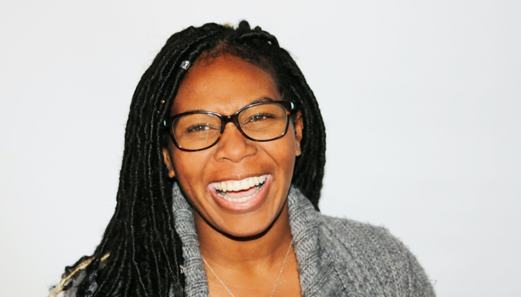 woman with glasses laughing
