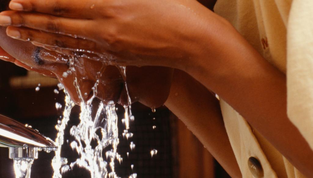 closeup woman washing face